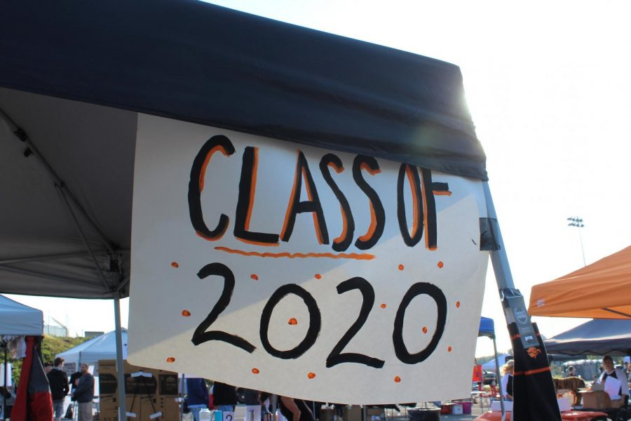The+Class+of+2020+sign+hands+above+the+Junior+Ways+N+Means%27+booth+at+Community+Day.