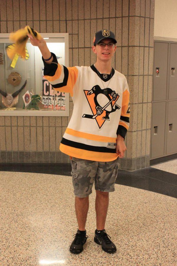 Tyler Schultz waves his Pens towel.