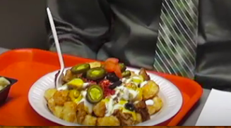 Loaded tots feature a bed of tater tots topped with meat covered with cheese and other toppings of choice.