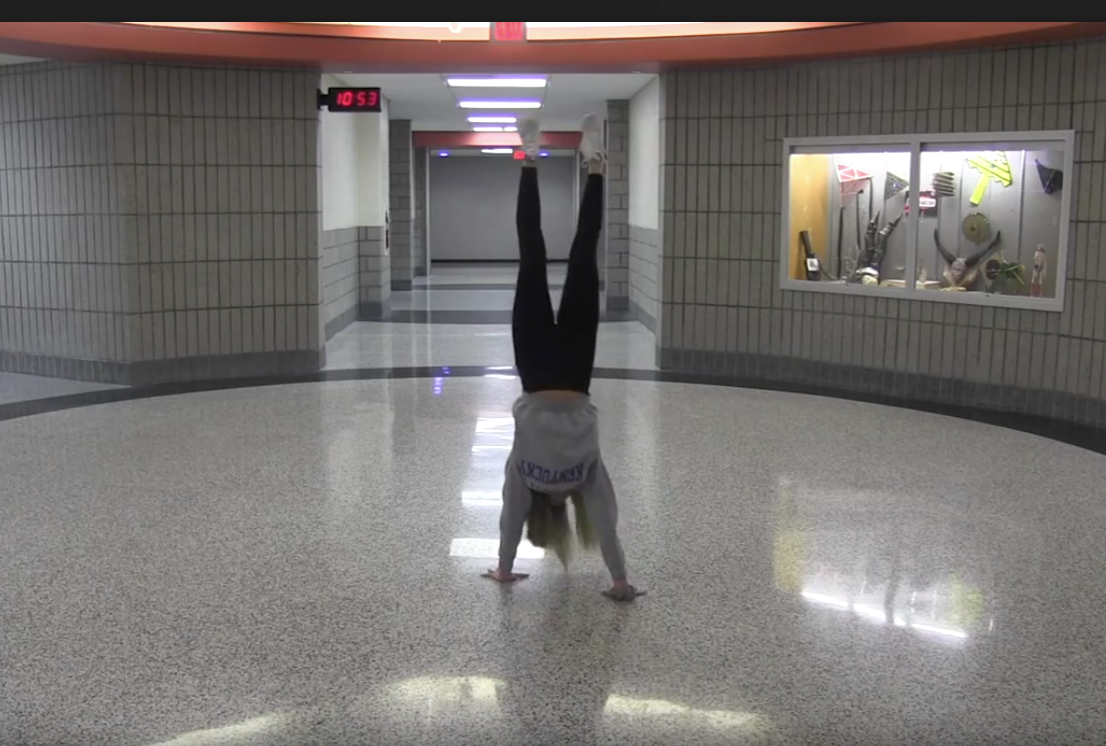 Chelsea Mariani walks on her hands in the 1st floor Rotunda.