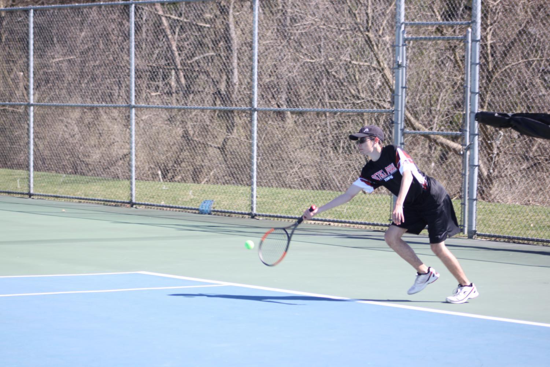 Adam+running+to+hit+the+forehand+