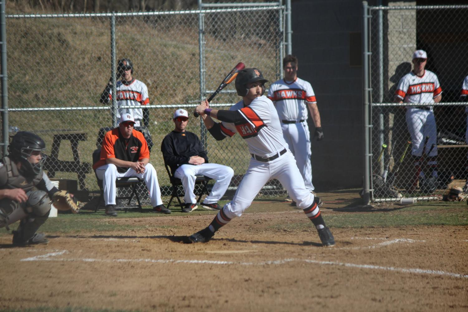 Anthony Strangis prepares to swing the bat during the Hawks' game vs. Pine Richland on March 27. The Hawks won 2-1.