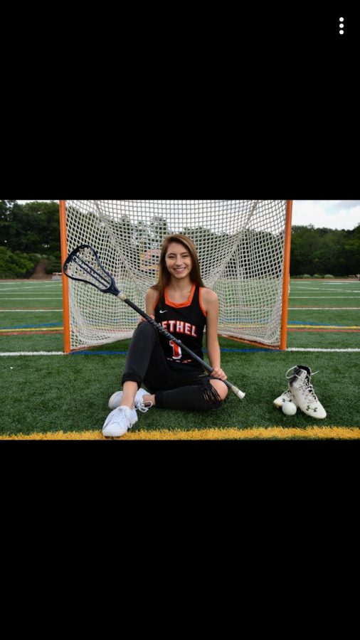 Sami smiles for her lacrosse pic