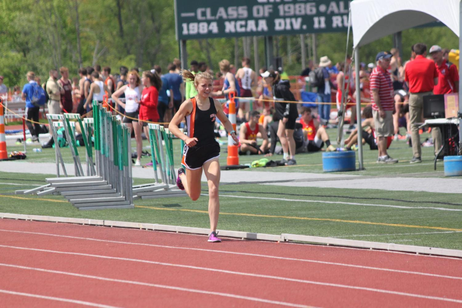 Emily Carter eyes the finish line in the 1600m run of the WPIAL Championships on May 16. Carter won the race in a time of 4:59.