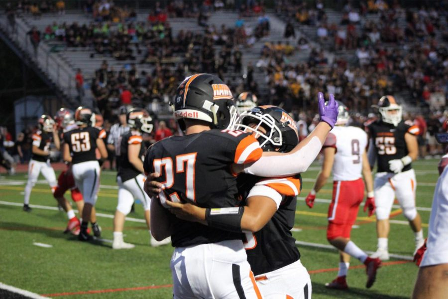 Hawks celebrate after a touchdown in their game against West Allegheny at home on Friday, Sept. 6.