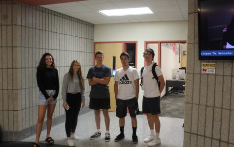 Students pose for a pic on Black and White Day during Homecoming Week.