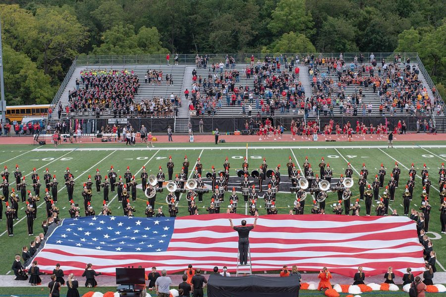 Head+Band+Director+Mr.+Thompson%2C+conducts+the+Star+Spangled+Banner+during+one+of+the+Pre-Game+performances.