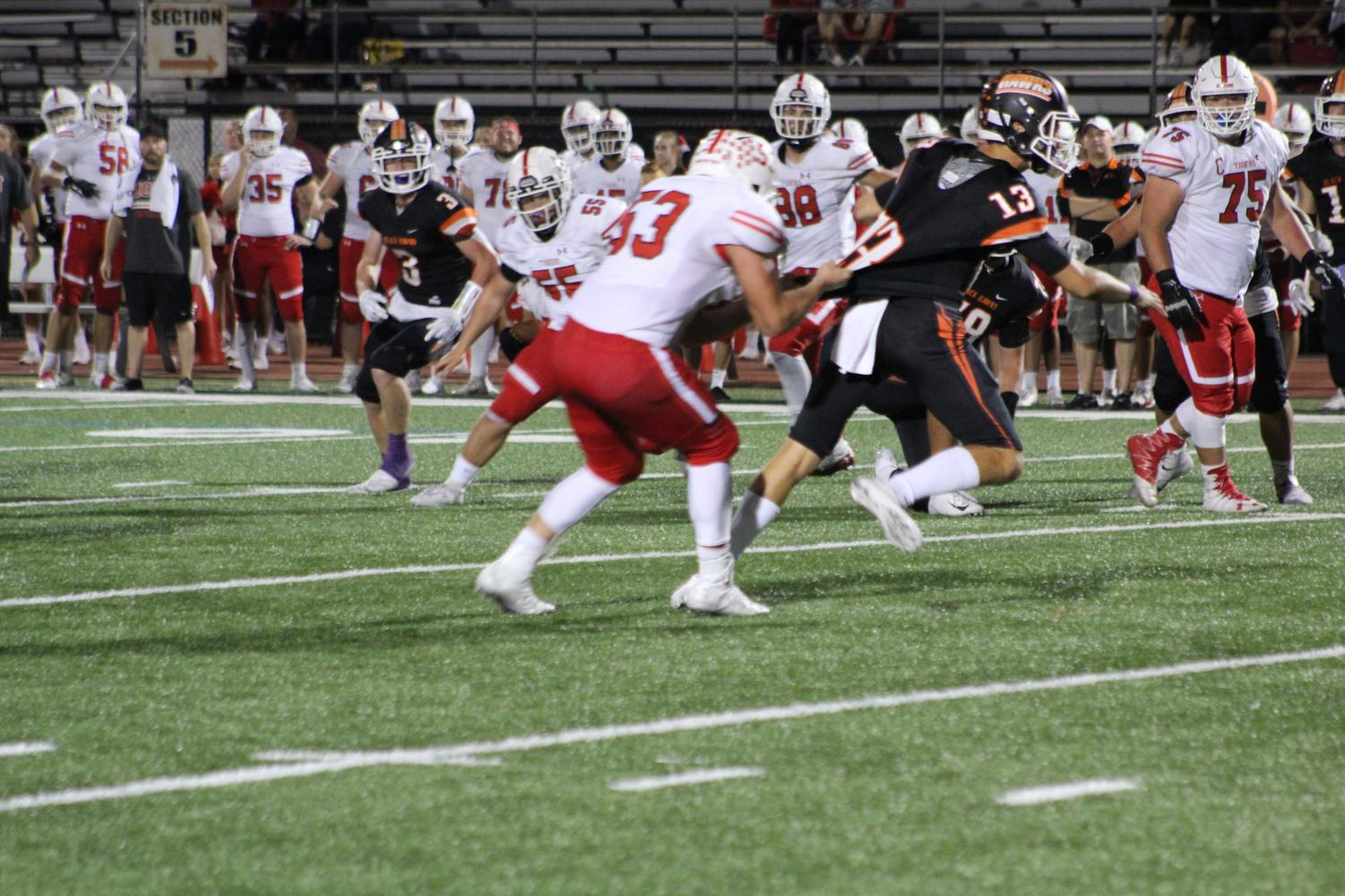 QB Anthony Chiccitt tries to escape the hands of the defense during the Hawks Homecoming game vs. Moon.