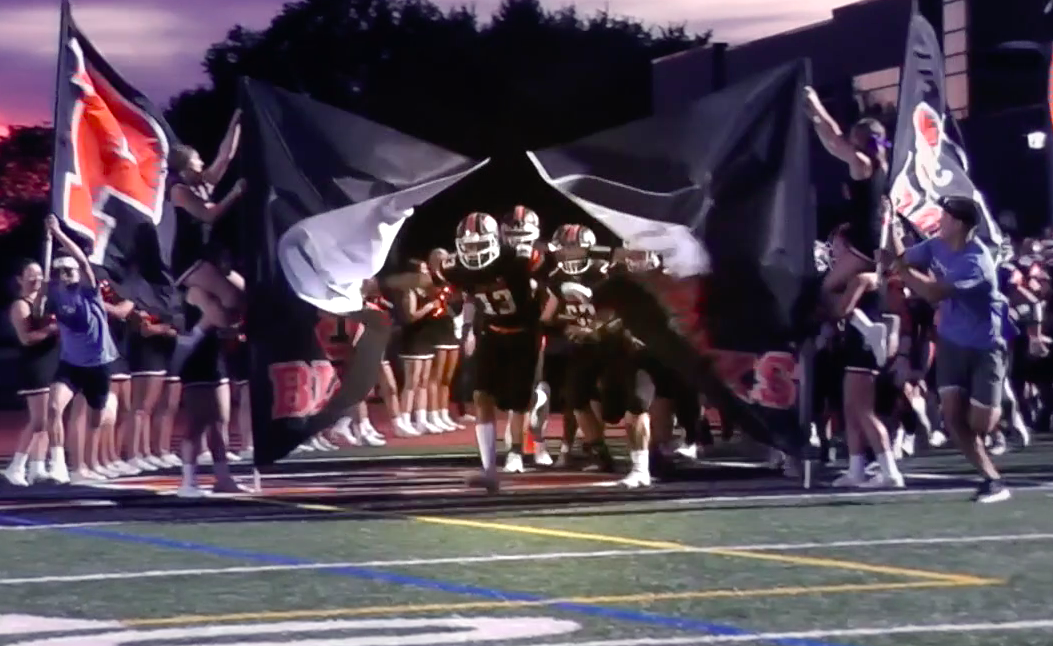 Anthony Chiccitt leads the Hawks onto the field before their game against Moon on Sept. 27.