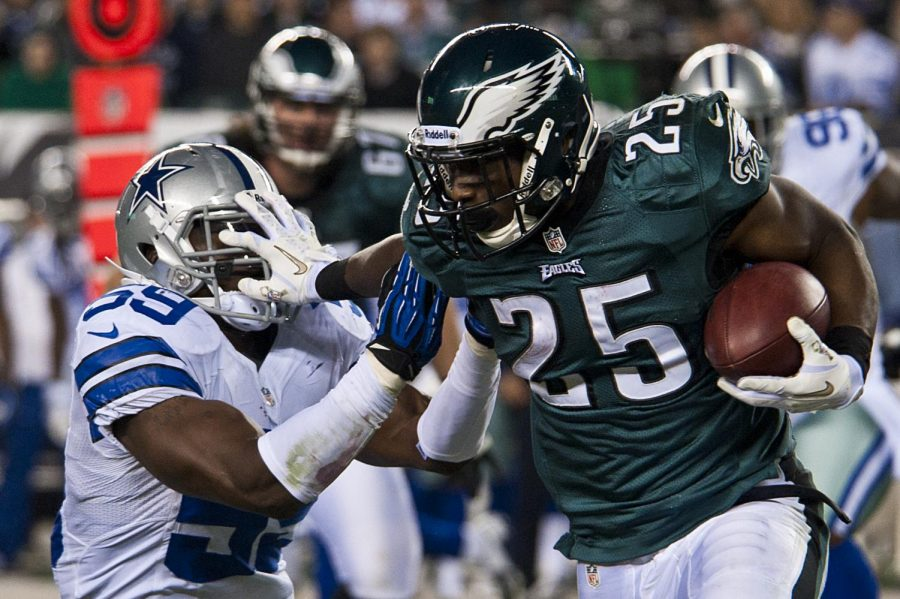 Philadelphia, Pa. - LeSean McCoy, Eagles running back, stiff arms Ernie Sims, Dallas Cowboys linebacker, as he runs the ball at Lincoln Financial Field in Philadelphia Nov. 11. The Marine Corps Silent Drill Platoon performed for at the Eagles' halftime show for tens of thousands of spectators this Veteran's Day to the chanting of