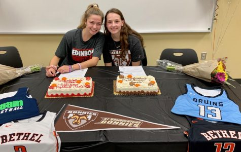 Lauren Mullen and Maddie Dziezgowski pose for a picture after signing their NLI's.