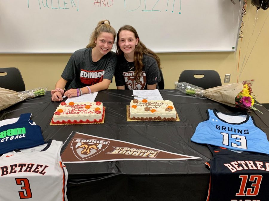 Lauren+Mullen+and+Maddie+Dziezgowski+pose+for+a+picture+after+signing+their+NLI%27s.