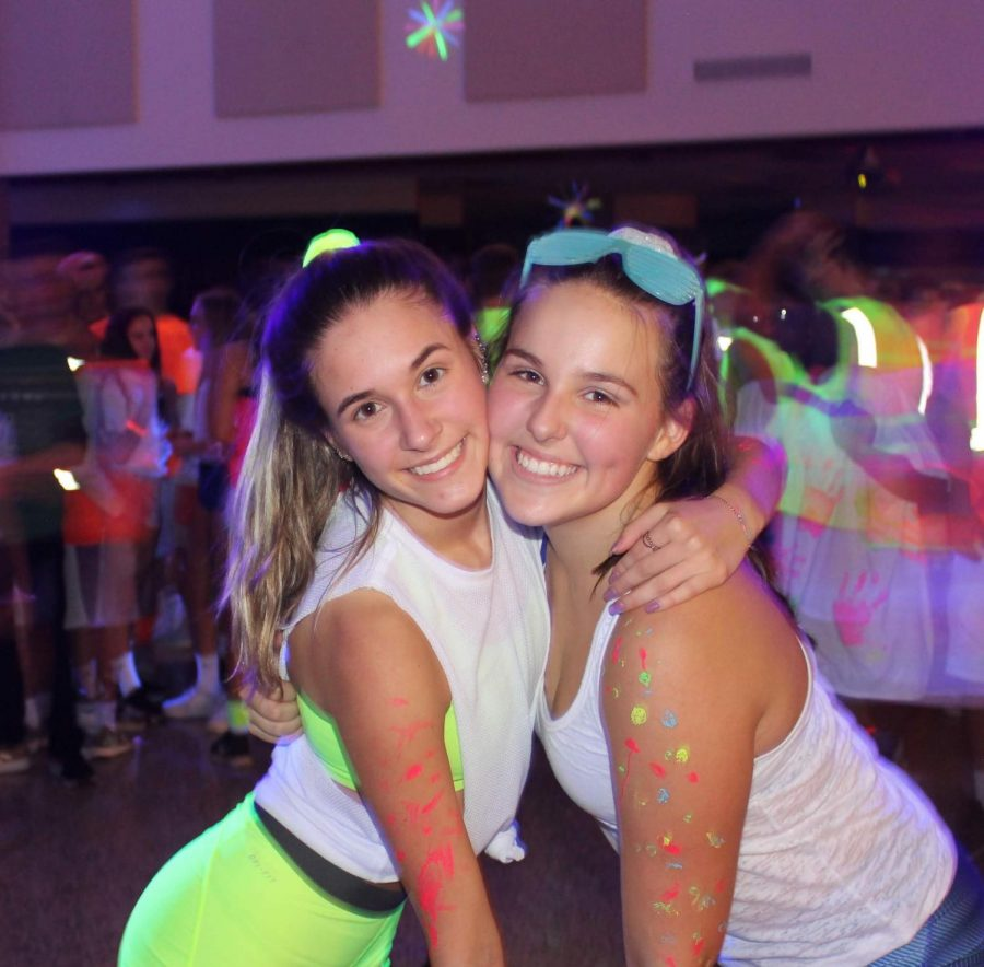Lindsay Cook and Kira Greer enjoying last year's Glow Fest dance.