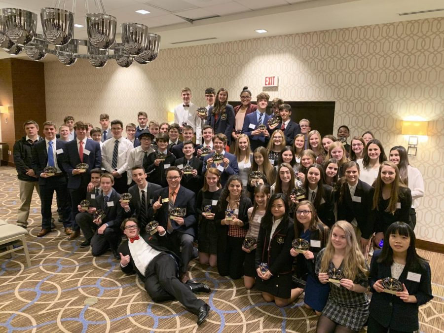 DECA+students+pose+with+their+trophies+at+the+DECA+Conference.