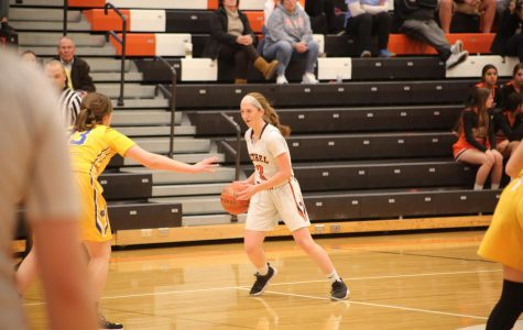 Riley Miller looks past a Canon-Mac defender for a pass during the Lady Hawks game vs. Canon-Mac on January 9.