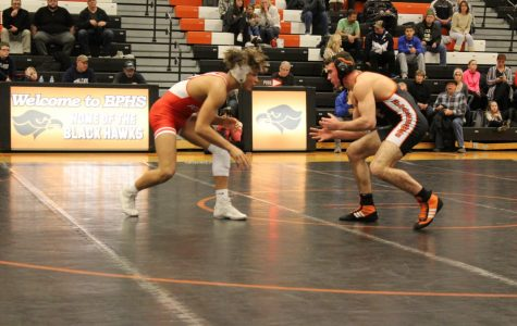 Hawks wrestling opens up busy week with big win over Highlanders