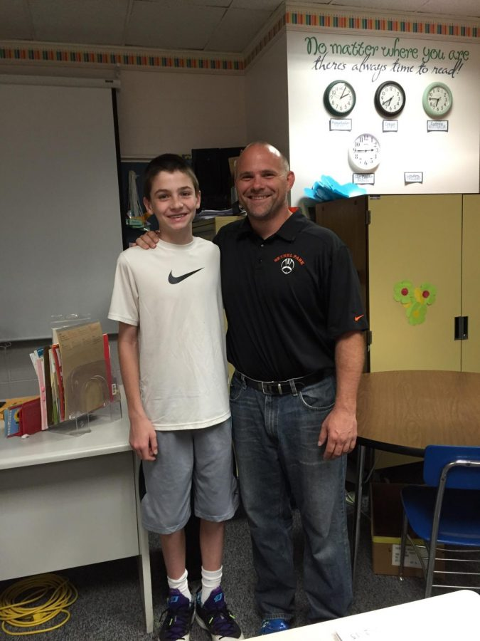 A much younger (and shorter) Tommy DiRienzo poses with his favorite teacher Mr. Miller at IMS.