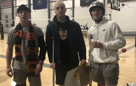Germaine Giants headmen Sean McGowan, Kevin Kogler, and Evan Bromley sport their walking boots, biking helmets and ace bandages at the team's most recent game Sunday night.