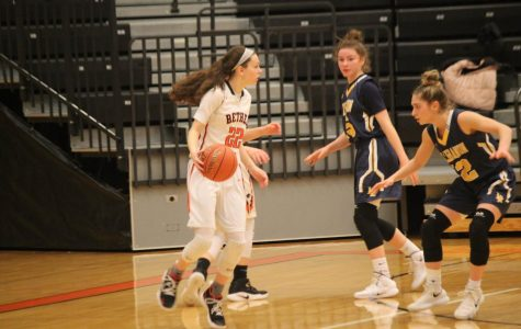 Olivia Westphal looks past two Lebo defenders in their game on January 24, 2019.