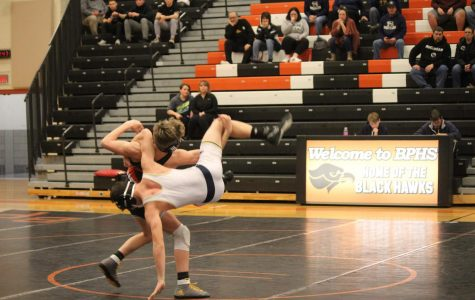 Bryson Bench (120 pounds) looks to score the takedown against his Ringgold opponent on Wednesday, Jan. 15.