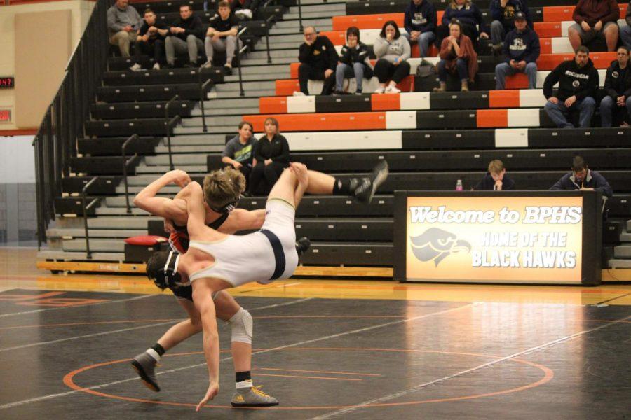 Hawks wrestling punches ticket to postseason