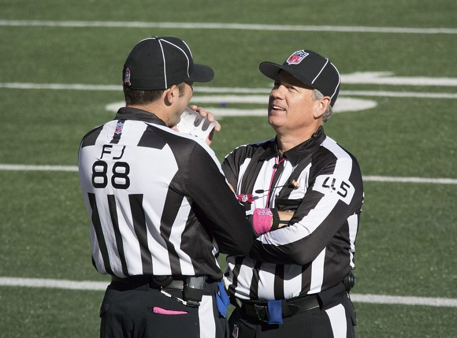 Referees+converse+at+the+Falcons+vs+Ravens+game+on+October+19%2C+2014.