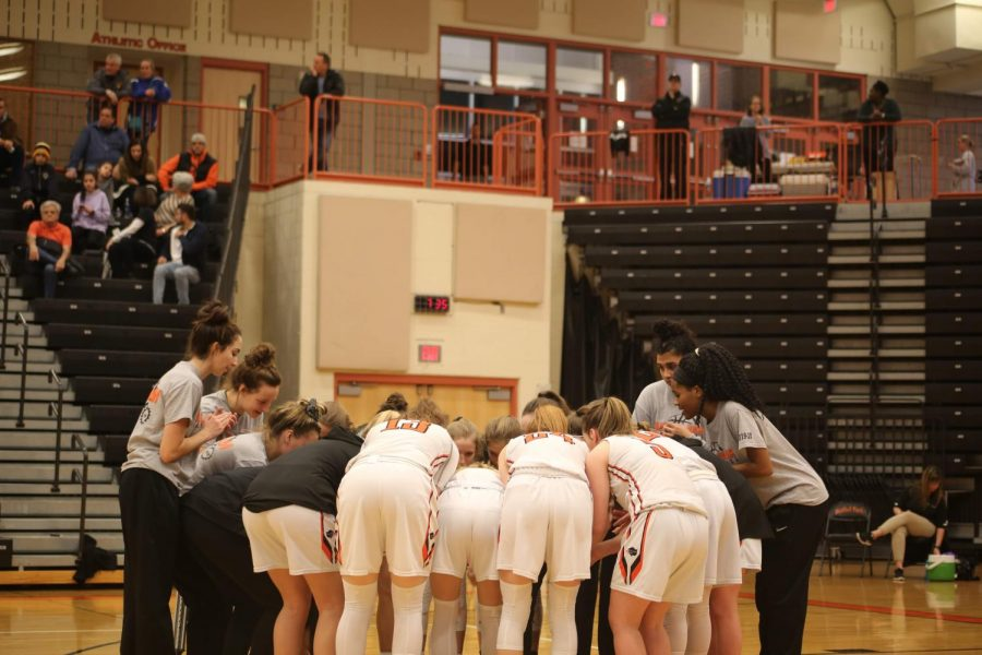 Girls basketball team huddles up during their game against Canon Mac on Jan. 9.