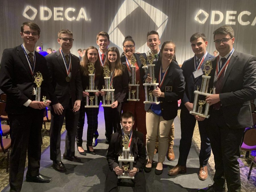 DECA+Finalists+proudly+hold+their+trophies.