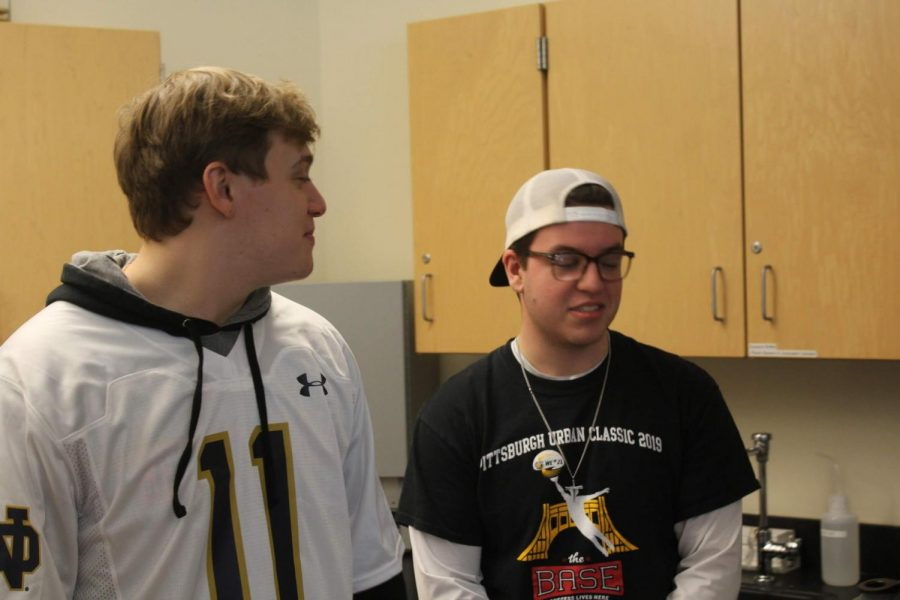 Anthony Celletti and Joey Turner show off spirit gear in the science lab.