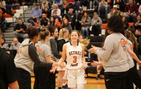 Lauren Mullen makes her way through the team tunnel before the Lady Hawks' game vs. USC on Jan. 20. Mullen was named an honorable mention on the Almanac girls basketball all-star list.