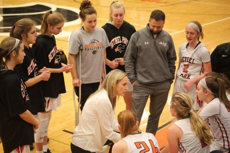 Coach Burke draws up a plan for the Lady Hawks during their game against Canon-Mac on Jan. 9.