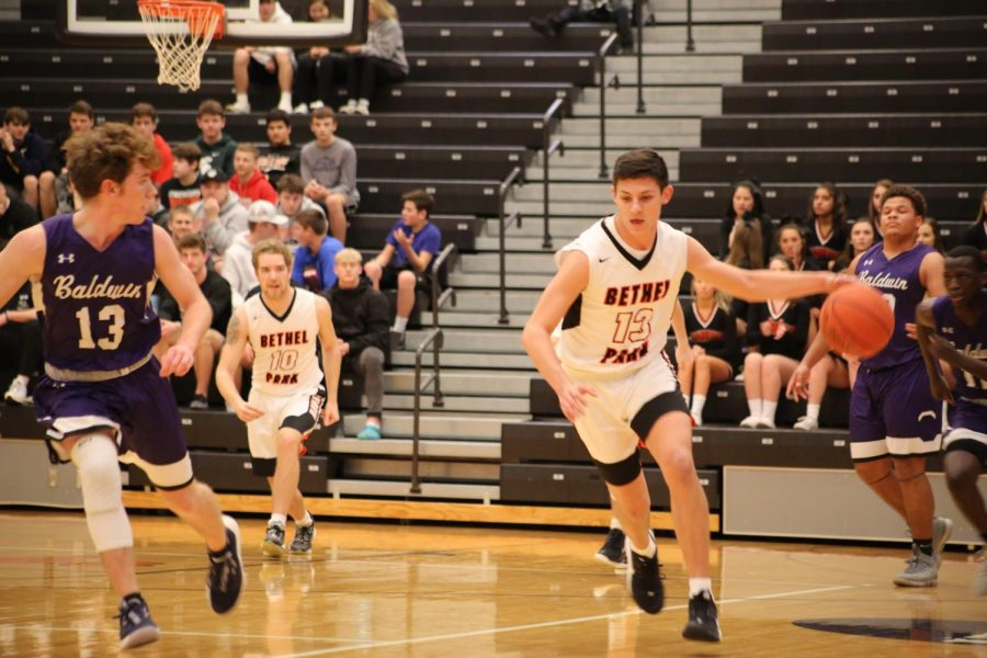 Anthony Chiccitt dribbles the ball down the court in the Hawks game vs. Baldwin on Jan. 14.