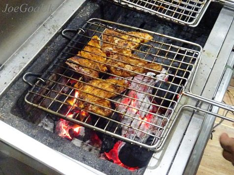 Chicken cooking on the grill. Chicken is an example of a high protein food.