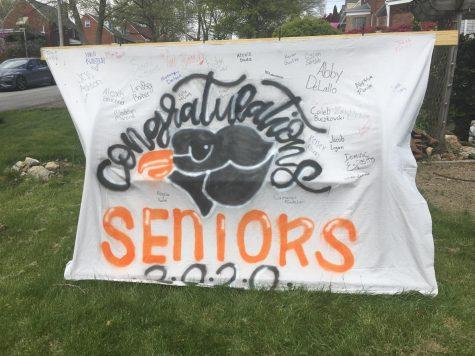 Seniors 2020 poster displaying many senior signatures outside the Tarr