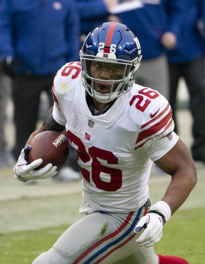 Saquon Barkley with the New York Giants carries the ball in a game against the Washington Redskins at FedEx Field on December 9, 2018 in Landover, Maryland.