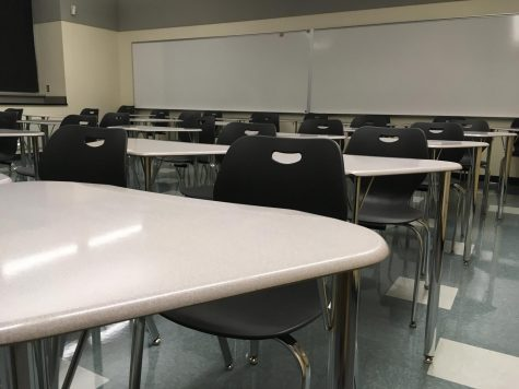 An empty classroom awaits the arrival of students.