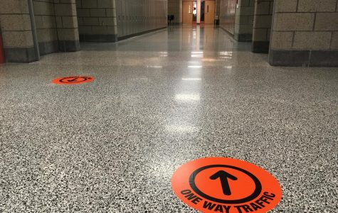 Students will be expected to follow one-way traffic in the halls when they return to school on Oct. 5.