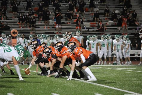 Hawks line up against the Lions during their game on Friday, Oct. 9.