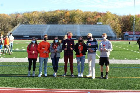 Ashleigh Sepesky, Jackson Banes, Courtney Kiesling, Toby Roule, Grace Myers, Bill Kumer, and Scott Orzechowski pose on the football field after being nominated to the Homecoming court.