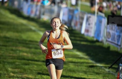 Jenna Lang preserving through the heat to make it to the finish line at PIAA Cross Country Championships at Hershey, PA on Nov. 7.