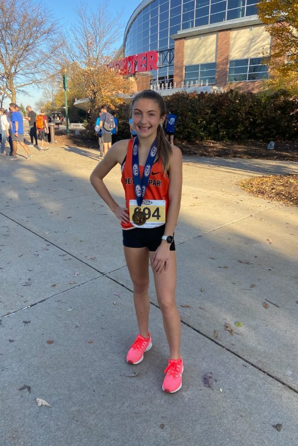 Jenna Lang poses with her seventh place PIAA medal outside the Giant Center in Hershey, Pa.