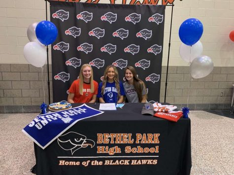 Reagan Milliken, Lauren Caye, and Delaney Nagy are all smiles after signing their NLIs.