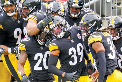 Pittsburgh Steelers free safety Minkah Fitzpatrick (39) is greeted by teammates in the end zone after intercepting a pass buy Cleveland Browns quarterback Baker Mayfield (6) and taking it in for a touchdown during the first half of an NFL football game, Sunday, Oct. 18, 2020, in Pittsburgh