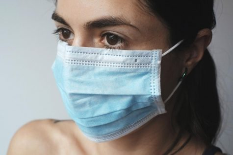 Instead of the standard surgical mask (seen here), many people from various cultures are getting creative with their masks during this pandemic.