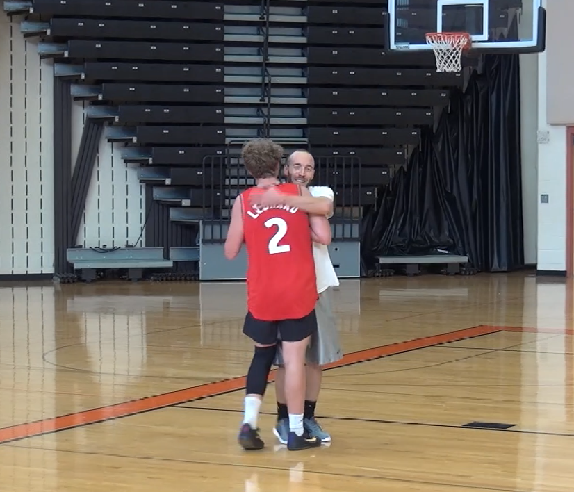 Mr. Travis and Nate Yoder embrace shortly after their 1v1 matchup on Oct. 24, 2019.
