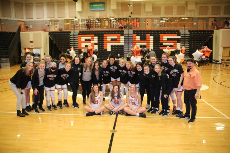 Lady Hawks are all smiles after a victory at home on Senior Night on Feb. 11.
