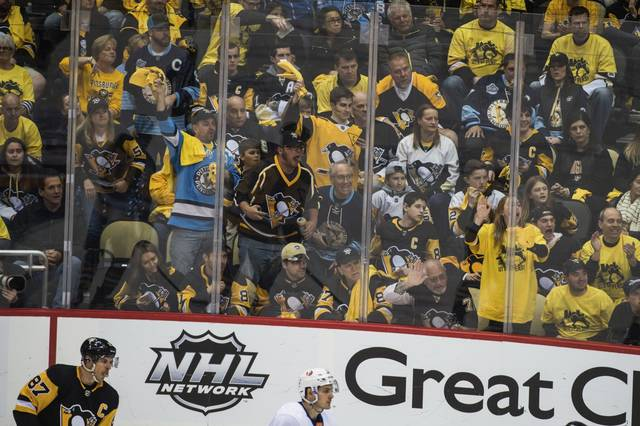 Fans+at+PPG+Paints+Arena+cheer+during+a+recent+Penguins+game.+Governor+Wolf+announced+Monday+that+he+is+revising+indoor+gathering+limitations.+Now%2C+indoor+events+are+allowed+15%25+of+max+occupancy.