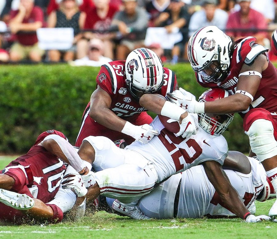 Najee+Harris+is+swarmed+by+South+Carolina+during+their+game+on+September+14%2C+2019.+The+Crimson+Tide+won+47-23.