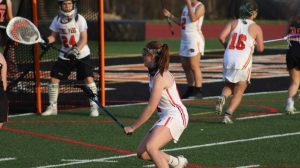 Starting midfielder Riley Miller defends her net against Latrobe on April 6.