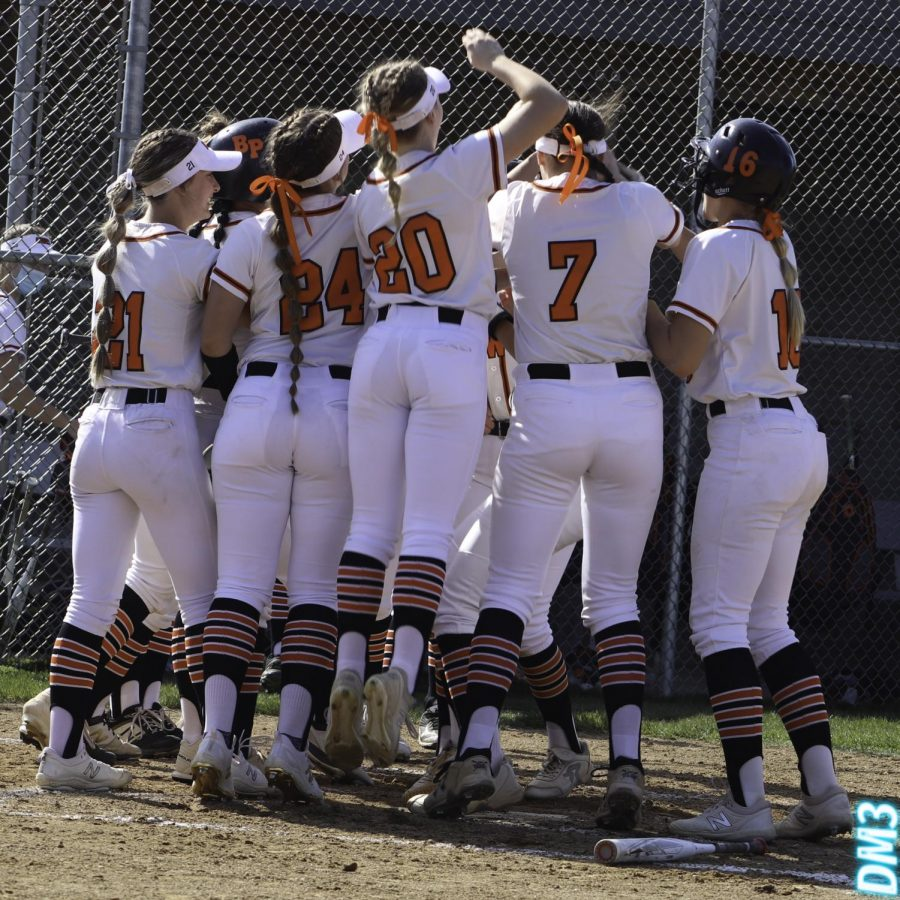 The softball team celebrates a moment during their game against Mt. Lebo on April 26.